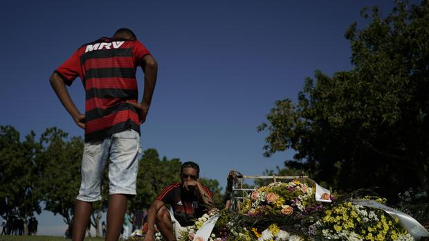 Friends and relatives grieve after fire in Brazil (Leo Correa/AP)