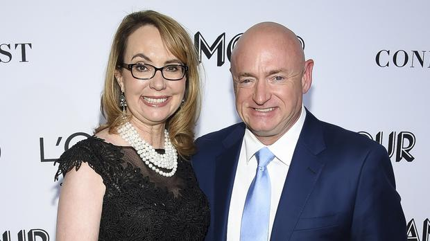 Politician and gun control advocate Gabrielle Giffords and husband, retired astronaut Mark Kelly who is hoping to finish the late John McCain's term in the US Senate (Evan Agostini/AP)