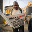 FIRST TO PRINT: A man at a newspaper stand in Kano, northern Nigeria, reads a copy of a newspaper which managed to print the news of the postponement in time. Photo: AP