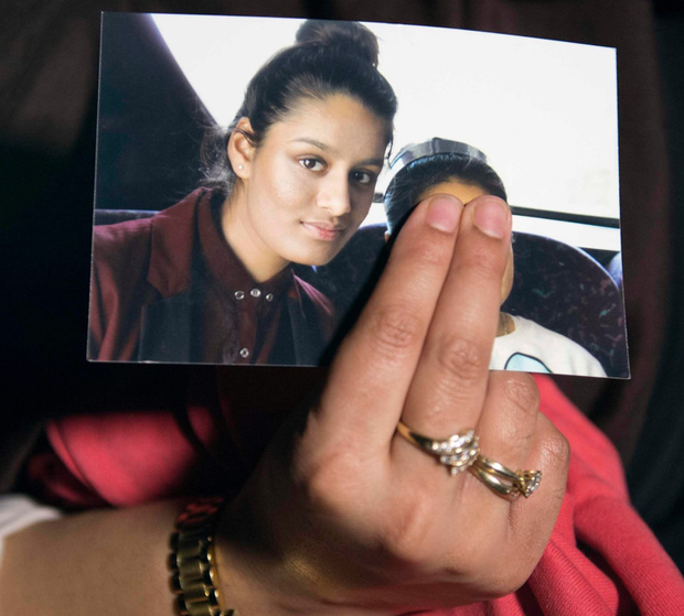 LOST GIRL: A sibling of Isil bride Shamima Begum, holds up her sister's picture