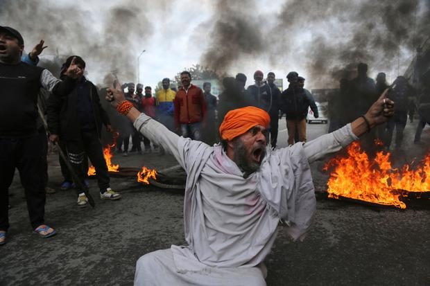 TENSION: A protester after last week's suicide car bombingby. Photo: AP