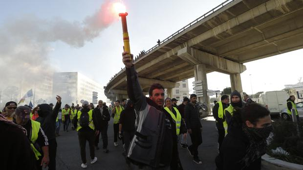 Yellow vest protesters march during a demonstration on Saturday in Marseille (AP Photo/Claude Paris)