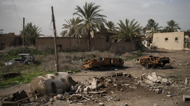 Damaged cars sit in an area recently retaken by US-backed Syrian Democratic Forces from Islamic State militants (AP Photo/Felipe Dana)