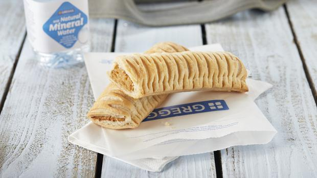 The launch of a controversial vegan sausage roll has helped bakery chain Greggs lift its full-year profit outlook after driving a surge in customers through its doors (Greggs/PA)