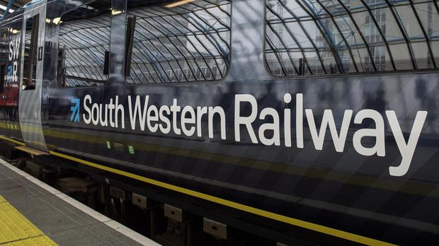 Transport giant FirstGroup has revealed slowing rail revenue growth after admitting a 'disappointing' service for passengers amid strike action on South Western Railway (PA)
