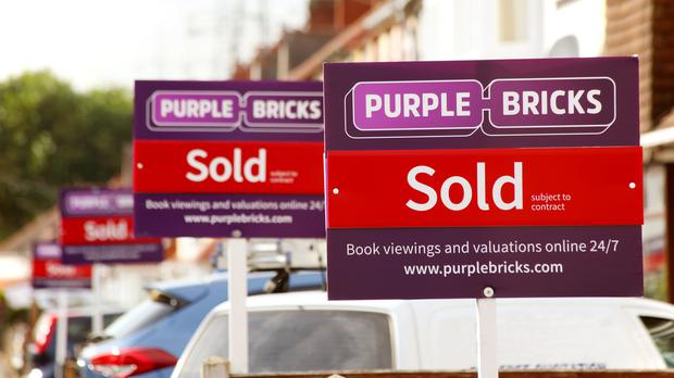 Undated handout file photo issued by Purplebricks of sold signs. The online estate agency cut its revenue guidance.