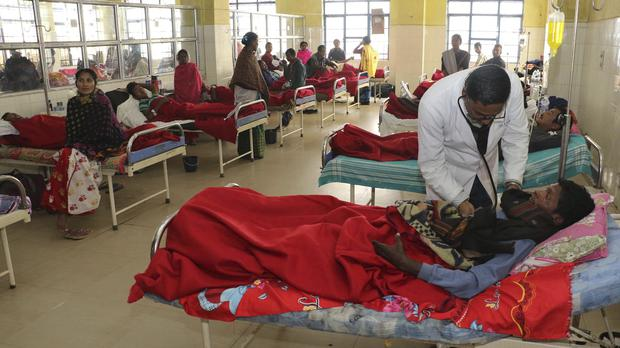 A doctor attends to a victim at a hospital in Jorhat (AP)