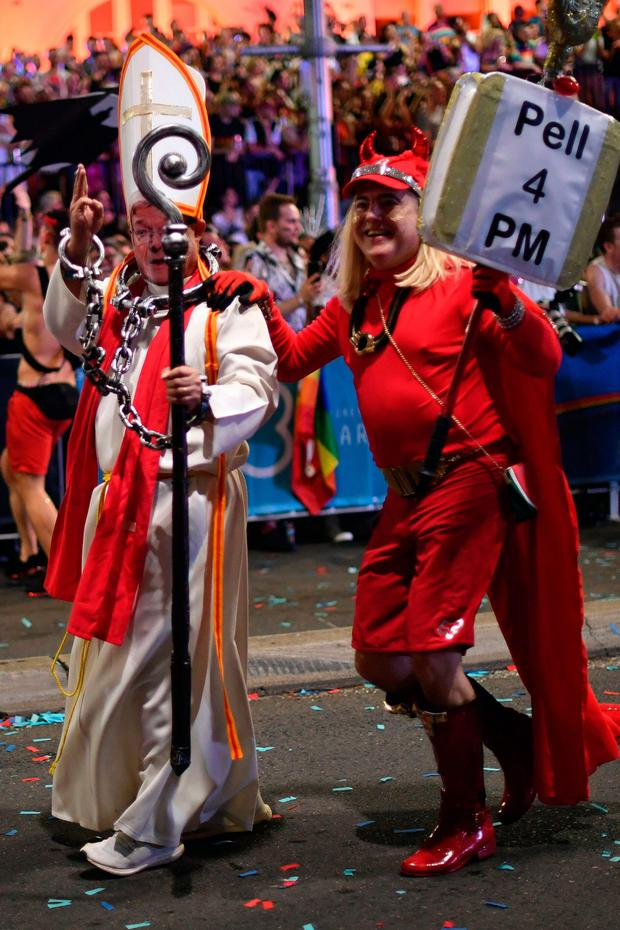 SARCASM: Marchers in yesterday's Gay and Lesbian Mardi Gras parade in Sydney make their feelings felt about Cardinal Pell. Photo: Getty