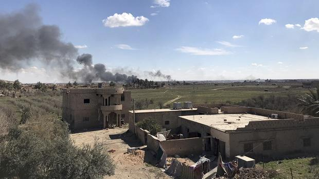 Columns of black smoke rise from the last small piece of territory held by Islamic State militants as US-backed fighters pound the area (Sarah El-Deeb/AP)