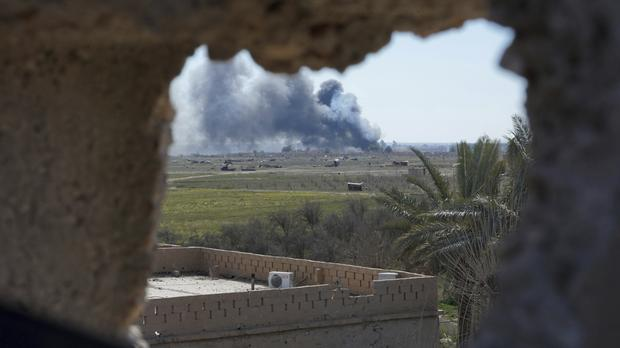 Columns of black smoke billow from the last small piece of territory held by Islamic State militants (AP Photo/Andrea Rosa)