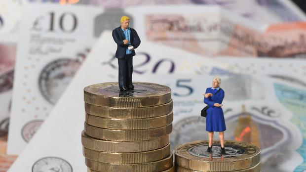 Increasing the number of women in employment and narrowing the gender pay gap could boost Britain's economy by billions of pounds, according to PwC (Joe Giddens/PA)