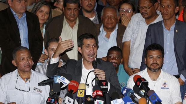 Juan Guaido gives a news conference at the end of his meeting with leaders of public employee unions (Fernando Llano/AP)