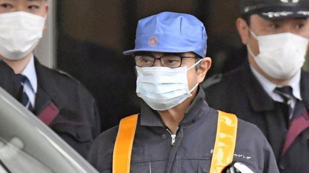 A man believed to be Carlos Ghosn leaves Tokyo Detention Centre (Kyodo News via AP)