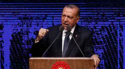 'No turning back': Turkey's President Recep Tayyip Erdogan missed a soft deadline to buy the US missile shield system. Photo: AP