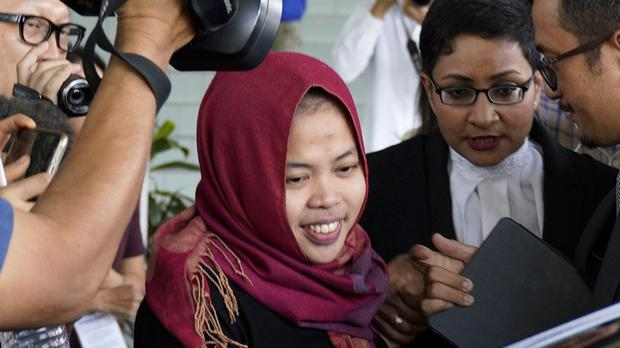 Indonesian Siti Aisyah smiles as she leaves Shah Alam High Court (Yam G-Jun/AP)