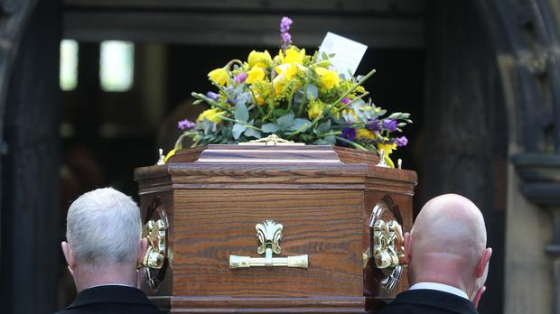 Dignity has reduced prices for its funeral packages in the past year (Owen Humphreys/PA)