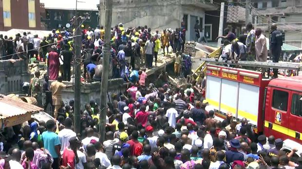 Rescue workers at the scene of a building collapse in Lagos, Nigeria (AP)