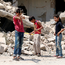 War games: Children play in a rebel-held part of Deraa, Syria. Photo: Reuters