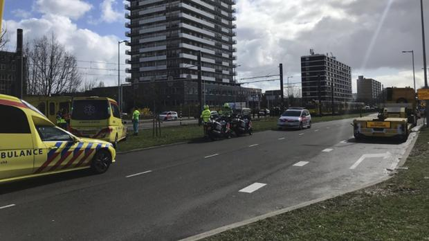 Emergency services attend the scene of a shooting in Utrecht (Martijn van der Zande/AP/PA)