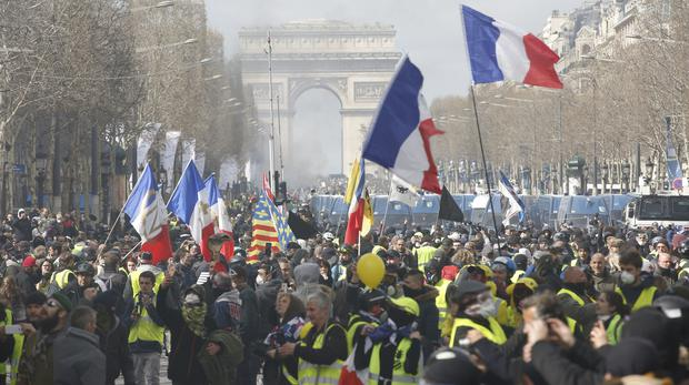 bc750bd6f1bc Yellow vest demonstrators invade the Champs-Elysees (Christophe Ena PA)