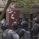 CounteR- terrorism police prepare to enter a house after the shooting incident (Peter Dejong/AP/PA)