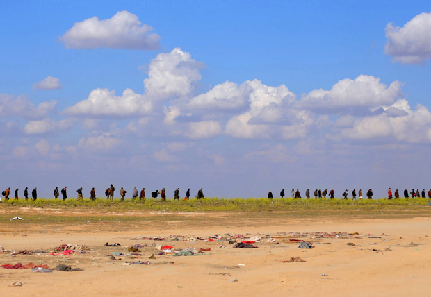 Uncertain times: Civilians walk together near Baghouz, Deir Al Zor province, in Syria. Photo: REUTERS/Rodi Said