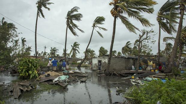 People return to their homes following a cyclone in the coastal city of Beira, Mozambique (Josh Estey/CARE via AP)