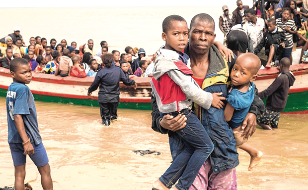 Rescue mission: Survivors of Cyclone Idai arrive by boat at an evacuation centre in Beira