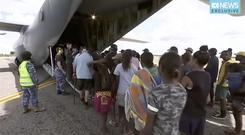 Storm evacuees board an Australian Defence Force C-130 plane preparing to take off from Borroloola (ABC/via AP)