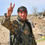 NOT OVER YET: An SDF fighter flashes the V for victory sign. Photo: Getty