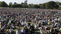 People gather for a vigil in Hagley Park (Mark Baker/AP)