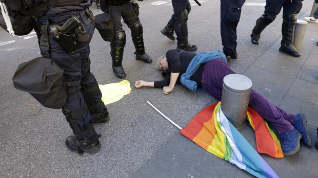Anti-globalisation activist Genevieve Legay, 73, lies unconscious after collapsing on the ground during a protest in Nice, southeastern France (Claude Paris/PA)