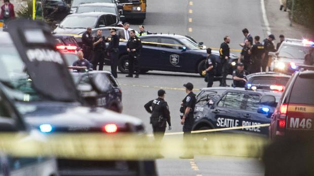 Investigators near the scene of a shooting in Seattle (Steve Ringman/The Seattle Times via AP)