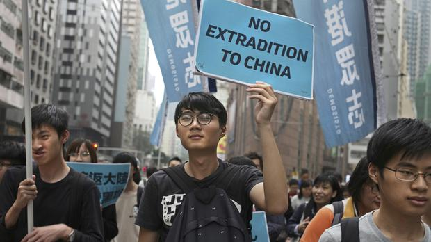 Protesters with placards and flags demonstrate in Hong Kong (Vincent Yu/AP)