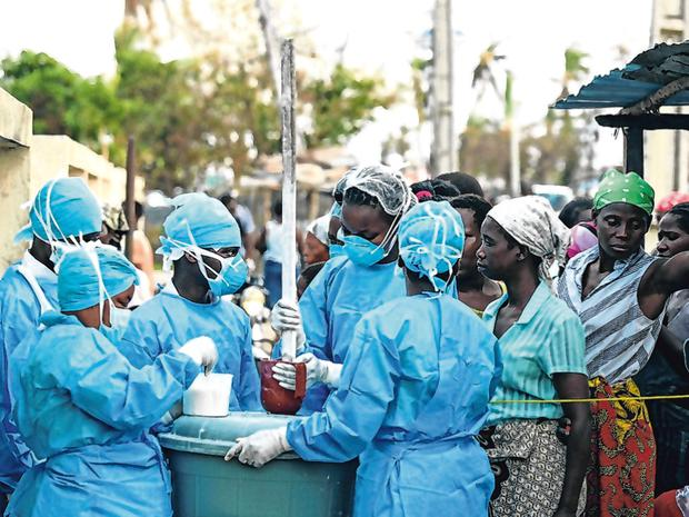 Battling: Medical staff at a health centre in Beira. Photo: Reuters