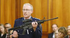 Police acting superintendent Mike McIlraith shows New Zealand politicians an AR-15 style rifle similar to one of the weapons a gunman used to slaughter 50 people at two mosques (Nick Perry/AP)