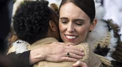New Zealand's PM Jacinda Ardern embraces a member of the Muslim community following the national remembrance service for the victims of the March 15 mosques terrorist attack (Mark Tantrum/AP)
