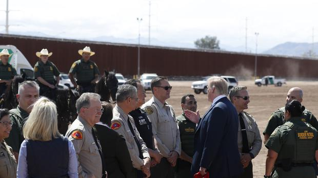 Donald Trump visits a new section of the border wall with Mexico in Calexico, California (Jacquelyn Martin/AP)