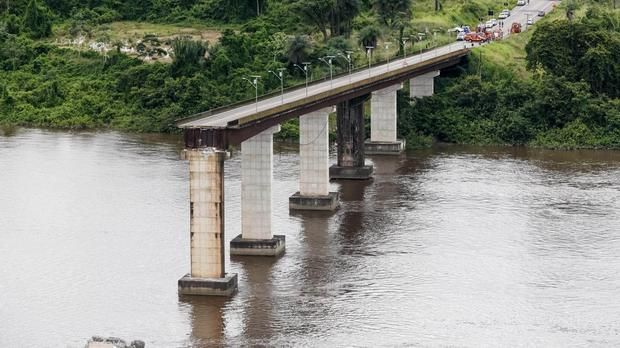 A ferry collided with a bridge pillar causing part of the bridge to collapse in the Moju river (Fernando Araujo/Para Government/AP)