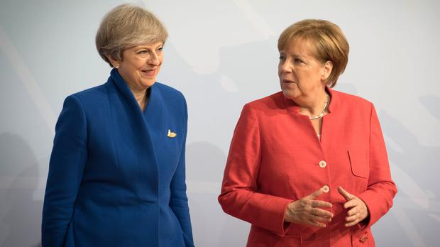 May meeting Merkel and Macron to seal Brexit extension