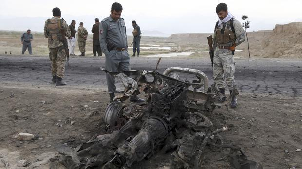 Afghan security forces gather at the site of the attack near the Bagram Air Base (AP)