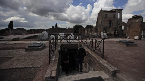 Journalists walk down the steps leading to the Domus Transitoria, the first imperial palace of Roman Emperor Nero on the Palatine Hill in Rome (Alessandra Tarantino/AP)