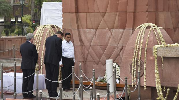 British High Commissioner to India Dominic Asquith, pays tribute to victims of the massacre (AP)