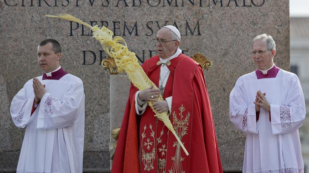 Pope Francis celebrates Palm Sunday Mass in St Peter's Square (Gregorio Borgia/AP)