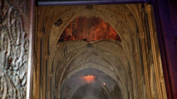 Flames and smoke are seen as the interior at Notre Dame cathedral (AP)