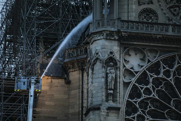 Firefighters are continuing to work at the cathedral (AP)