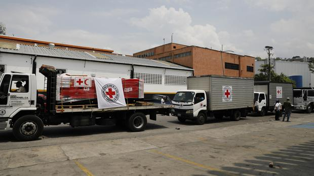 A convoy of trucks arrive with the first shipment International Federation of Red Cross and Red Crescent Societies humanitarian aid (Ariana Cubillos/AP)