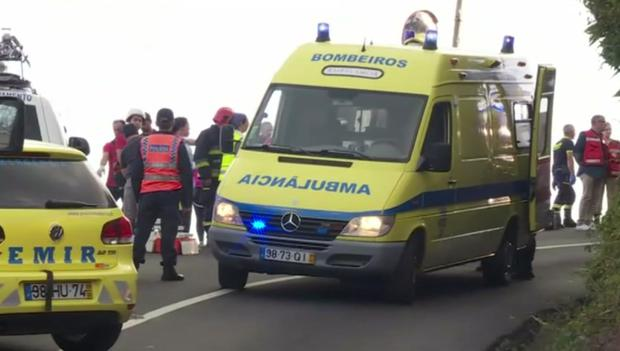 Emergency services attend the scene after the crash (TVI/AP)