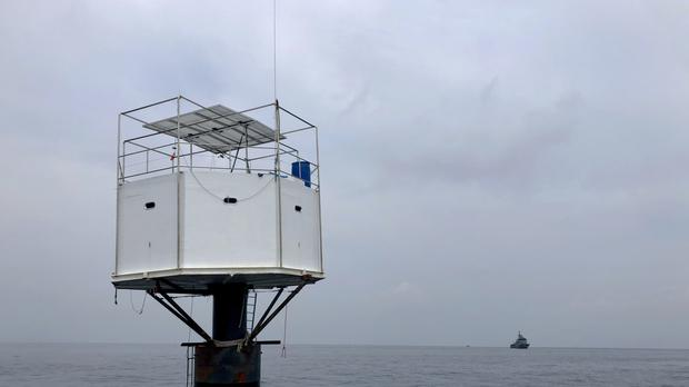 The floating home lived in by an American man and his Thai partner in the Andaman Sea (Royal Thai Navy via AP)
