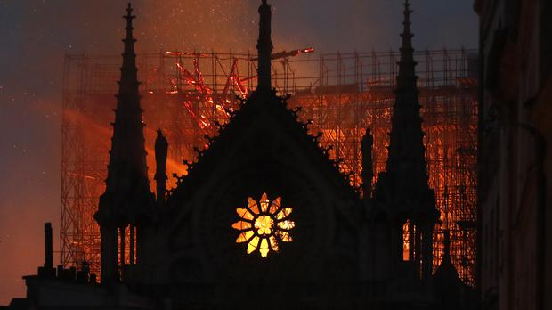 Flames and smoke rise from Notre Dame cathedral (Thibault Camus/AP)